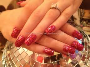 Photos acrylic nails with red glitter and 3d reindeer poinssettia