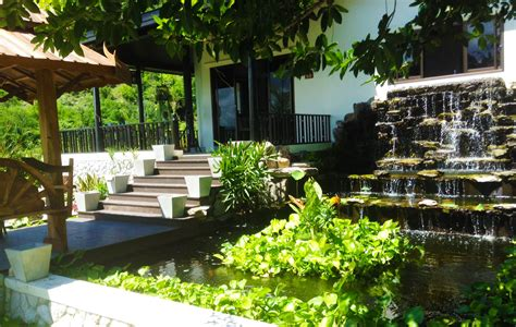 large waterwall pond and thai style front garden for resort home in cha am thai garden design