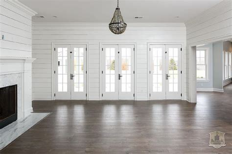 White Shiplap white shiplap living room with gray beaded chandelier transitional living room