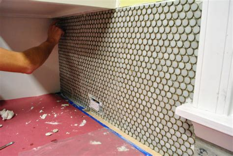 make a penny backsplash for an expensive look creative ideas cutting penny tile can be tricky what worked for us