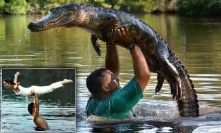 alligator whisperer lance lacrosse lifts reptile