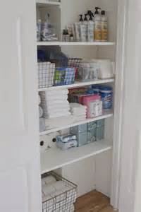 organized bathroom closet simply well linen features woven baskets and wire