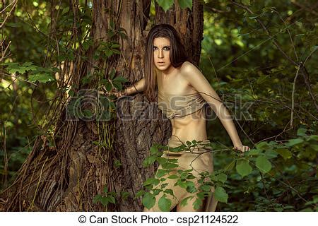 beautiful woman by the tree looking up stock photo image stock photo of savage girl looks out from behind a tree