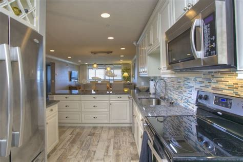 traditional kitchen with galley crown molding marazzi