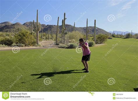 swinging golf club golf swing arizona golf course stock images image 36676034