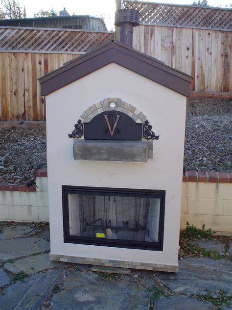 via themed outdoor pizza oven w a place insert