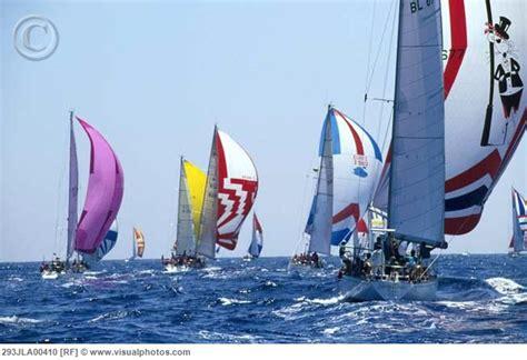 sailboats under sail sailboats under spinnaker in sail race sailboat