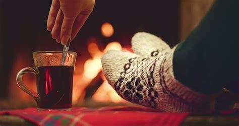 sock fireplace by the fireplace in woollen socks taking a