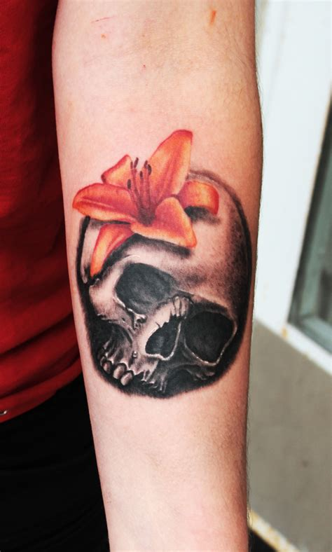 skull and lily tattoo by teedark on deviantart