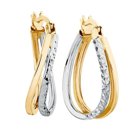 Huggie The huggie earrings in 10ct yellow white gold