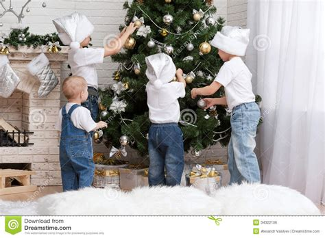 children decorate a christmas tree toys stock photo