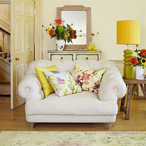 Pale Yellow Living Room | pale yellow living room with floral cushions living room