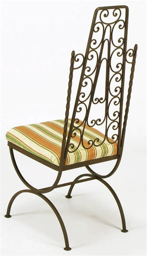 four revival wrought iron filigree dining chairs