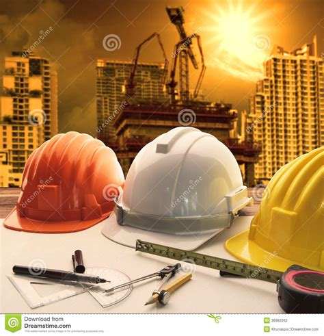 Design House Blueprint Free safety helmet on architect engineer working table with