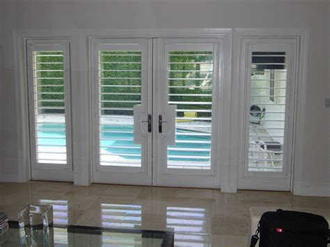 traditional style window treatment custom sewing traditional miami by maria j window miami french door shutters entry traditional with bahama mediterranean chandeliers window covering