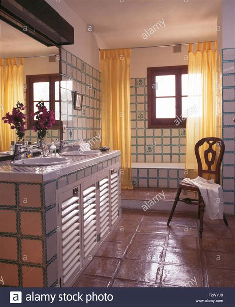 what is curtains in spanish yellow shower curtains on bath in tiled spanish country