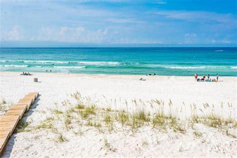 2 neighboring pcb beachfront homes for sale