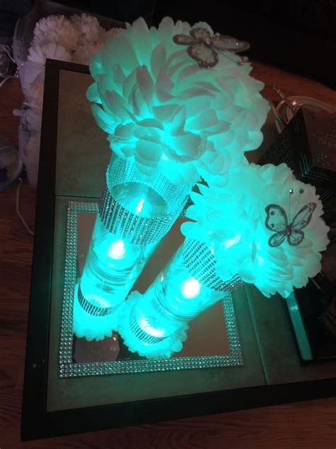 quinceanera centerpieces vase with light tissue poms and