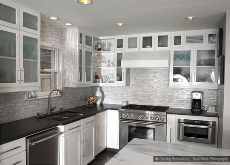 backsplash tile with white cabinets white kitchen cabinets black countertop quicua