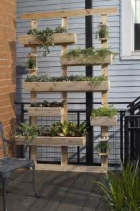 Look by putting up the slats and nailing small box planters on them