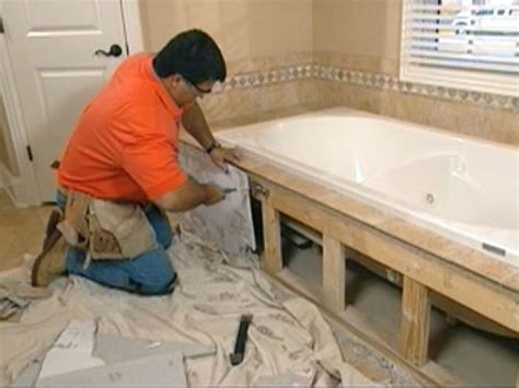how to install tile around a bathtub claw foot tub installation surround demolition how tos