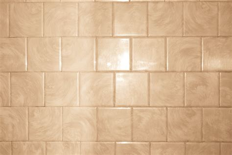 Tan bathroom tile with swirl pattern texture picture free photograph photos public domain