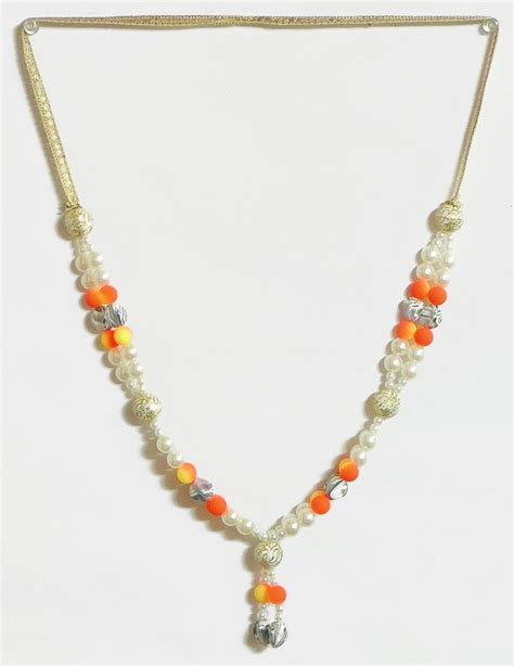 white and saffron bead garland