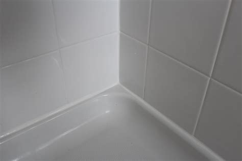 bathtub grout or caulk 13 diy tips for caulking bathroom shower tiles joy