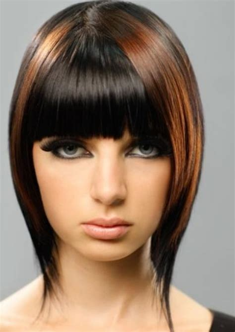 very short hairstyle with highlights lift and a bump on cool asymmetrical bob with highlights and bang