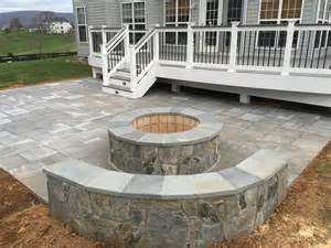 backyard patios with fire pits a beautiful paver patio with stone seating walls and a