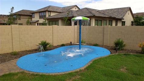 how to make a backyard splash pad residential splash pads landscaping network