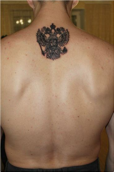 small back tattoos for men 50 meaningful and small designs for