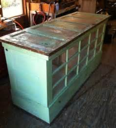 upcycled kitchen ideas turn old doors into a kitchen island or cabinet these