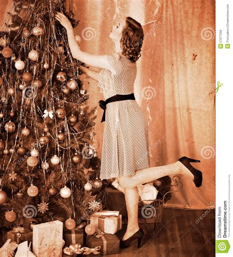 woman dressing christmas tree stock photo image 27677550