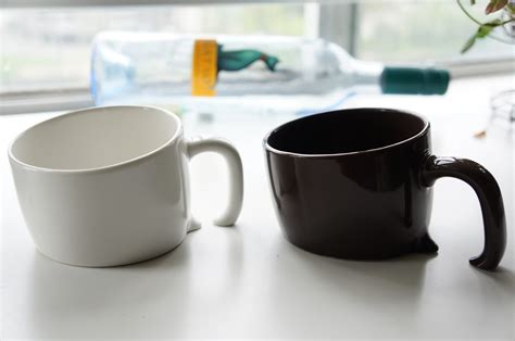 Cool Mug | half buried coffee mug stuff you should have