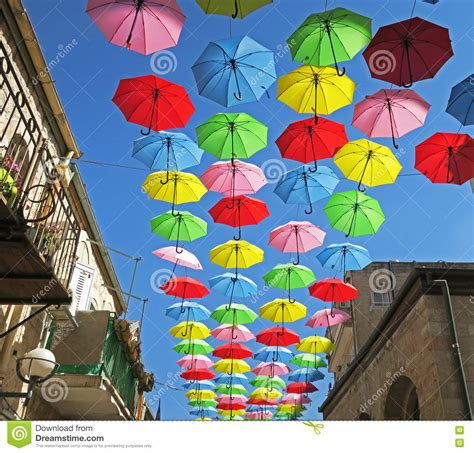 X2 3746 St Umbrella rainy day protection with flying umbrellas in a summer festival stock photo image of