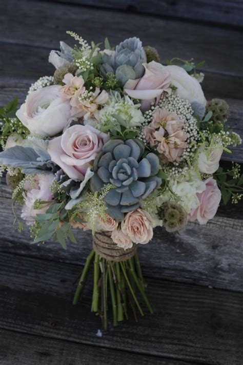 a shabby chic bridal bouquet featuring succulents dusty
