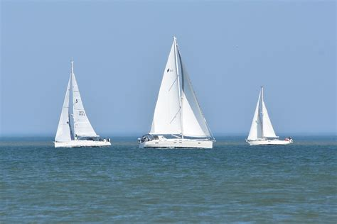 on a boat sailing free photo boats sailboats boat free image on pixabay