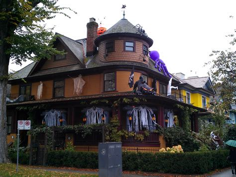 decorated homes for halloween here s the best time to buy a house business insider
