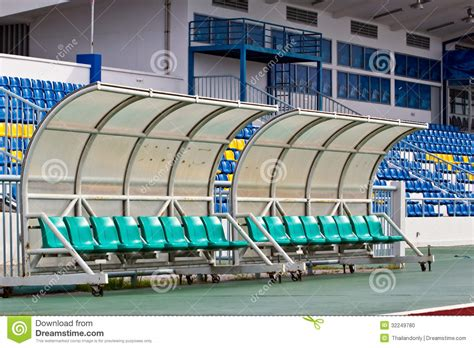 stadium benches coach and reserve benches in football stadium stock photo