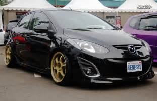 mazda 2 history of model photo gallery and list of