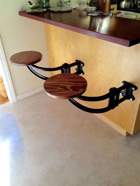 Swing Arm Wall Mounted Bar Stools by Wall Mounted Swing Out Seat Suspended Cast Iron Swing