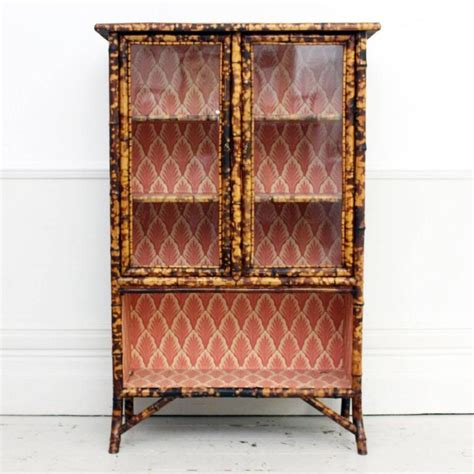 Antique Tiger Bamboo Glass Fronted Display Cabinet with Vintage Wallpaper at 1stdibs
