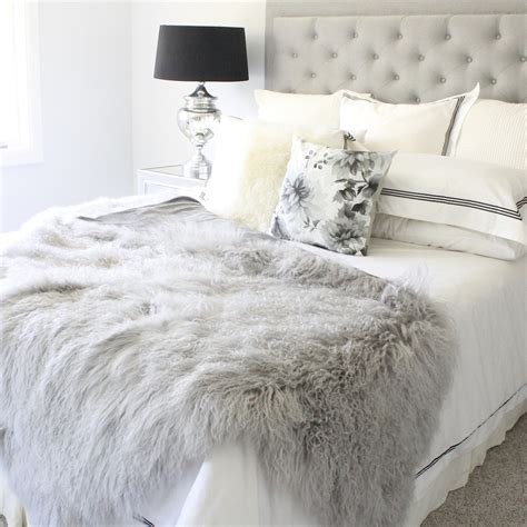 grey mongolian fur tibetan sheepskin throw blanket and bed