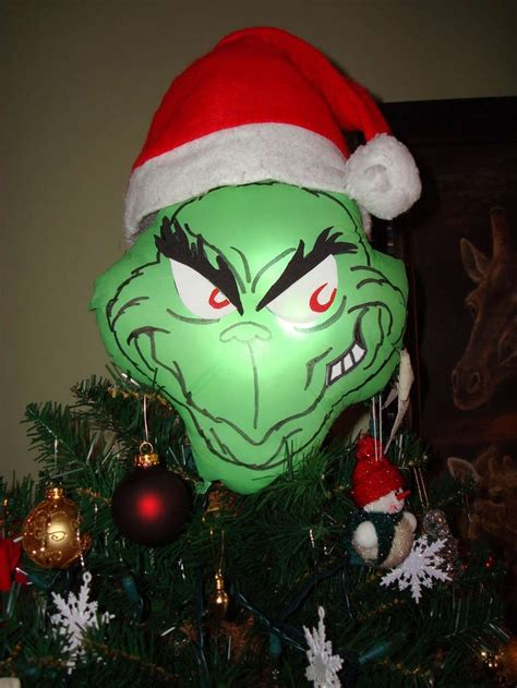 grinch tree topper christmas tree themes pinterest