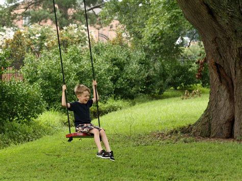 kids swings for trees how to make a tree swing hgtv