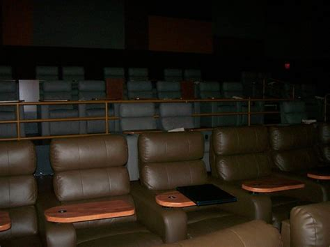 movie theaters with recliners in ma at the top of the escalator heading into the lobby area