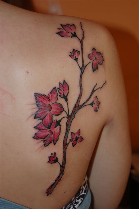 cherry blossom tattoo on side cherry blossom tattoos designs ideas and meaning