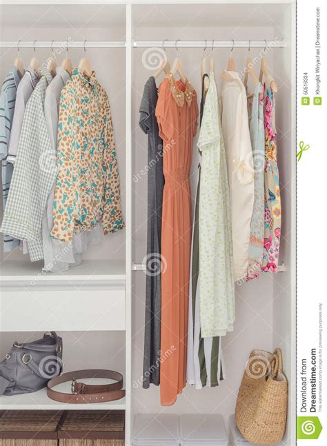 White Closet Dresses by White Closet With Dress Hanging On Coat Hanger Stock Photo