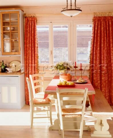 country style kitchen table with bench ac051 10 a country style open plan kitchen with din narratives photo agency